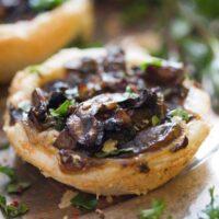 mushroom pies with parmesan sprinkled with herbs