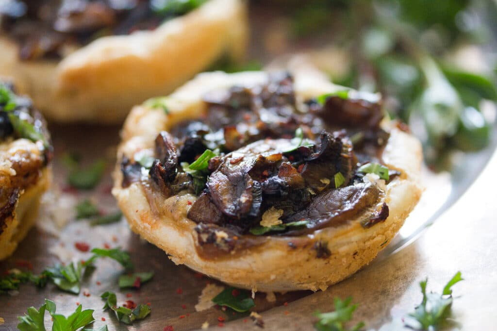 mushroom pies with herbs and parmesan close up shot