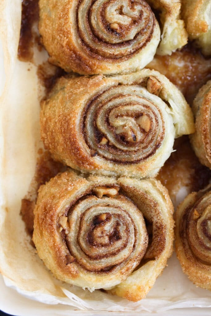 overhead shot puff pastry cinnamon rolls in a small baking tray