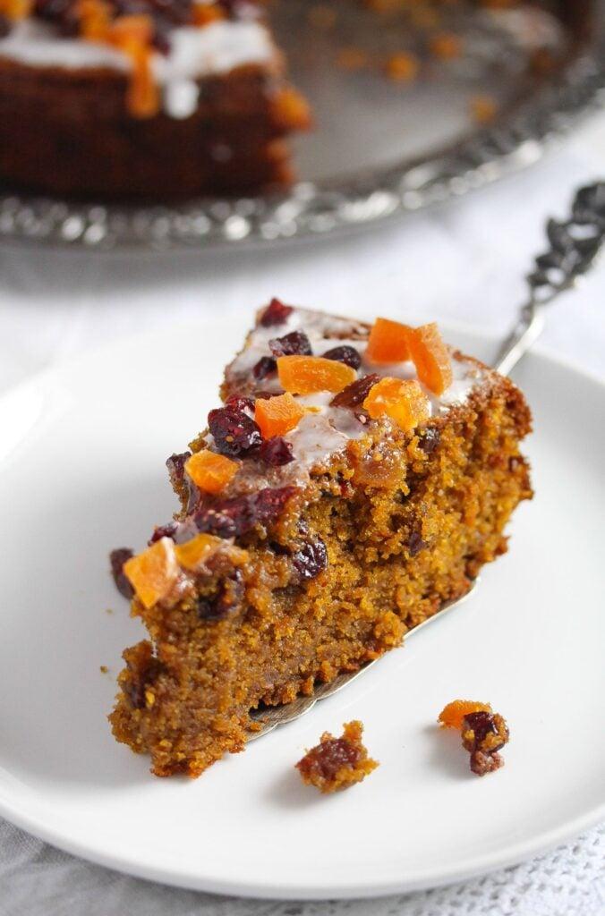 slice of pumpkin fruitcake on a small white plate