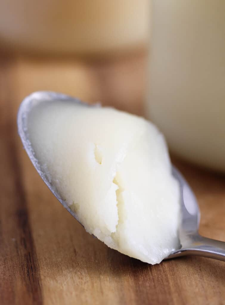 solid white fat on a spoon