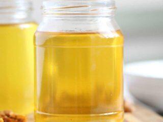 golden rendered turkey fat in two jars