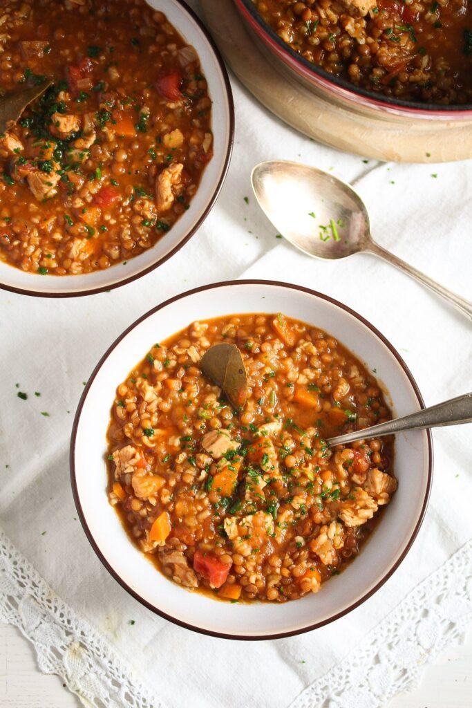 overhead shot of lentil turkey soup in bowls