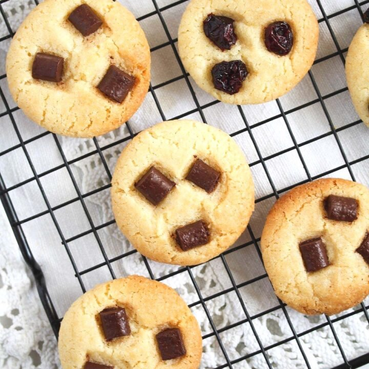 condensed milk cookies with chocolate chips on a wire rack