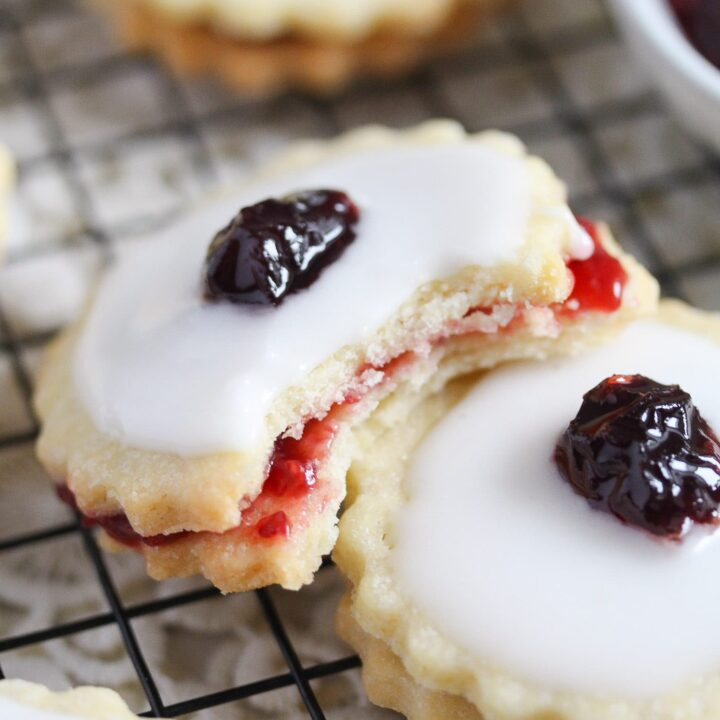 close up of a german biscuit filled with raspberry jam