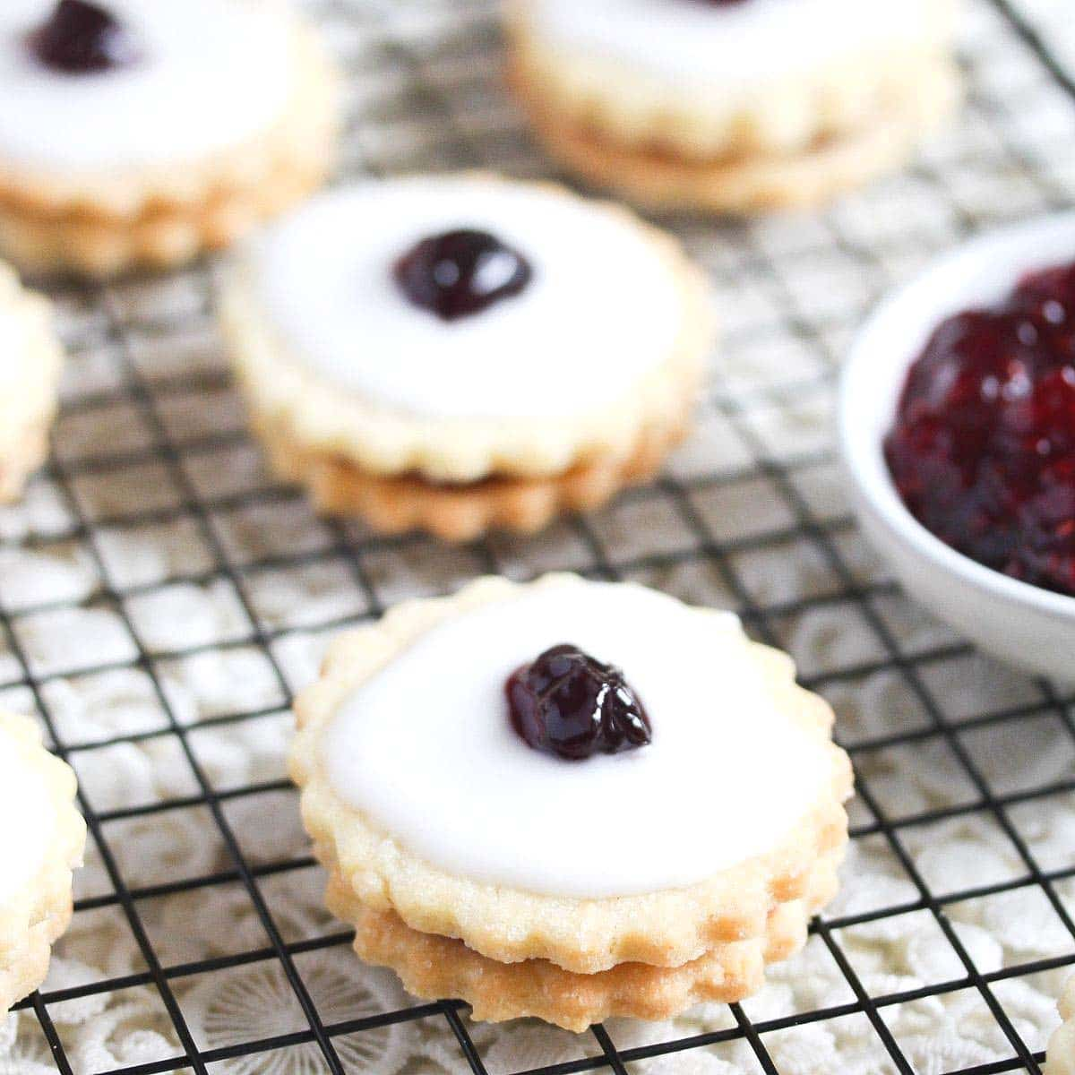 empire biscuits filled with jam on a wire rack