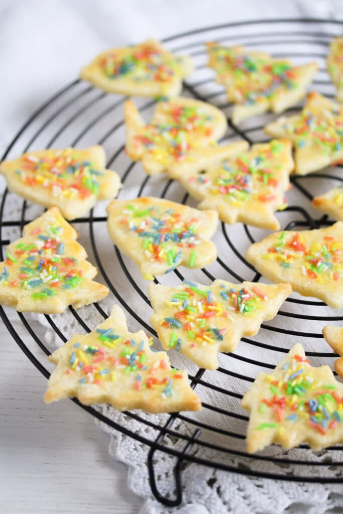 cookies with sprinkles on a wire rack