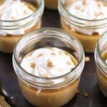 pots de creme topped with whipped cream