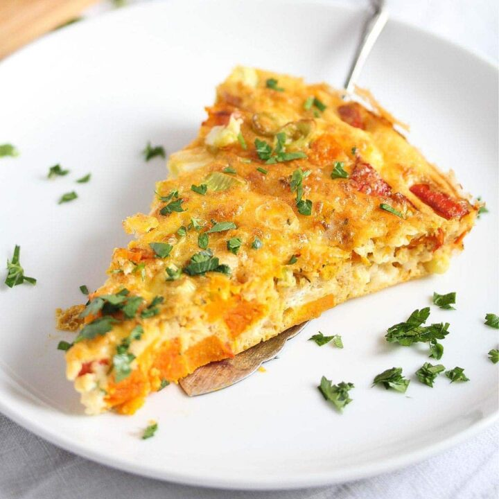 pumpkin frittata slice on a white small plate