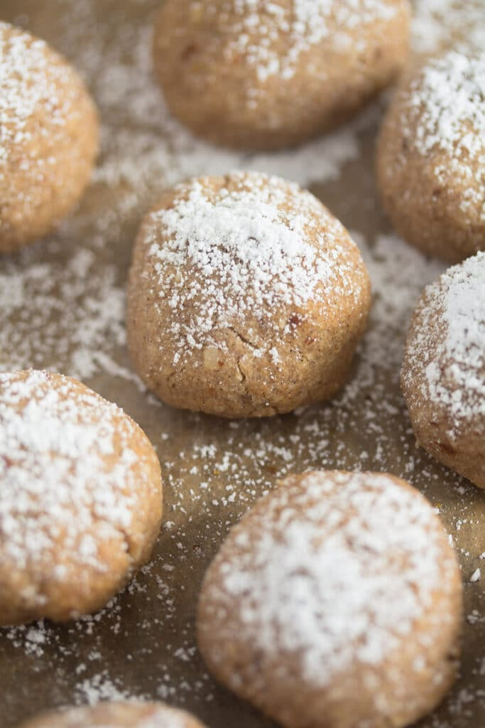 polvoron cookies on baking paper sprinkled with powdered sugar