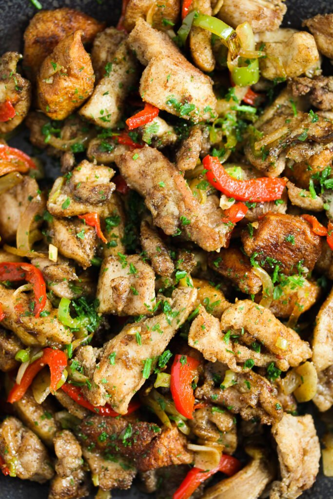 close up fried chicken pieces and peppers