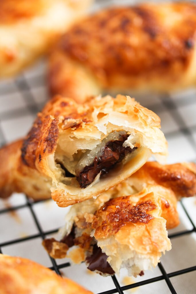 close up showing the chocolate filling of a small croissant