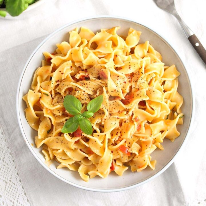 pasta in coconut milk in a large bowl