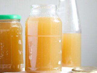 homemade venison bone broth in jars and bottles