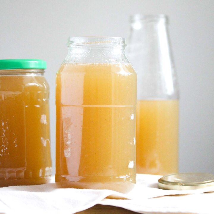 homemade venison bone broth in jars and bottles