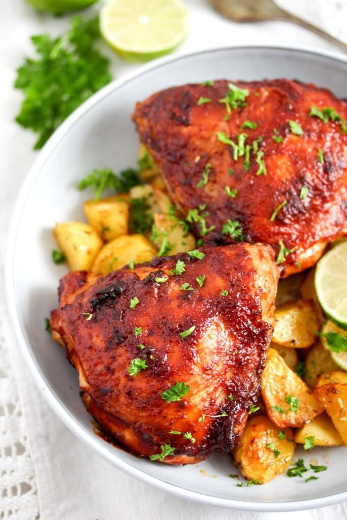 chicken glazed with barbecue sauce served with potatoes
