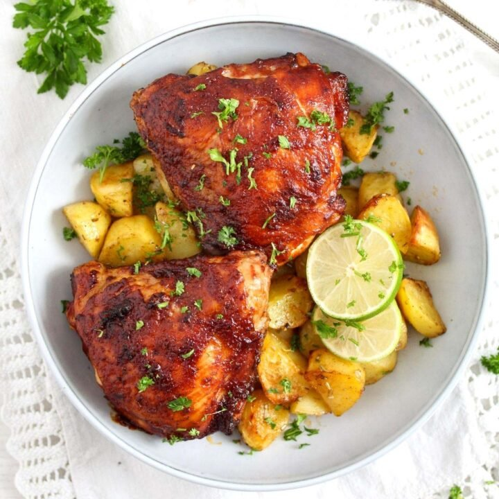 air fryer bbq chicken served with potatoes and limes
