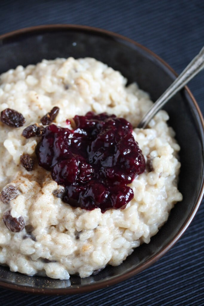 condensed milk rice with raisins and blueberry sauce