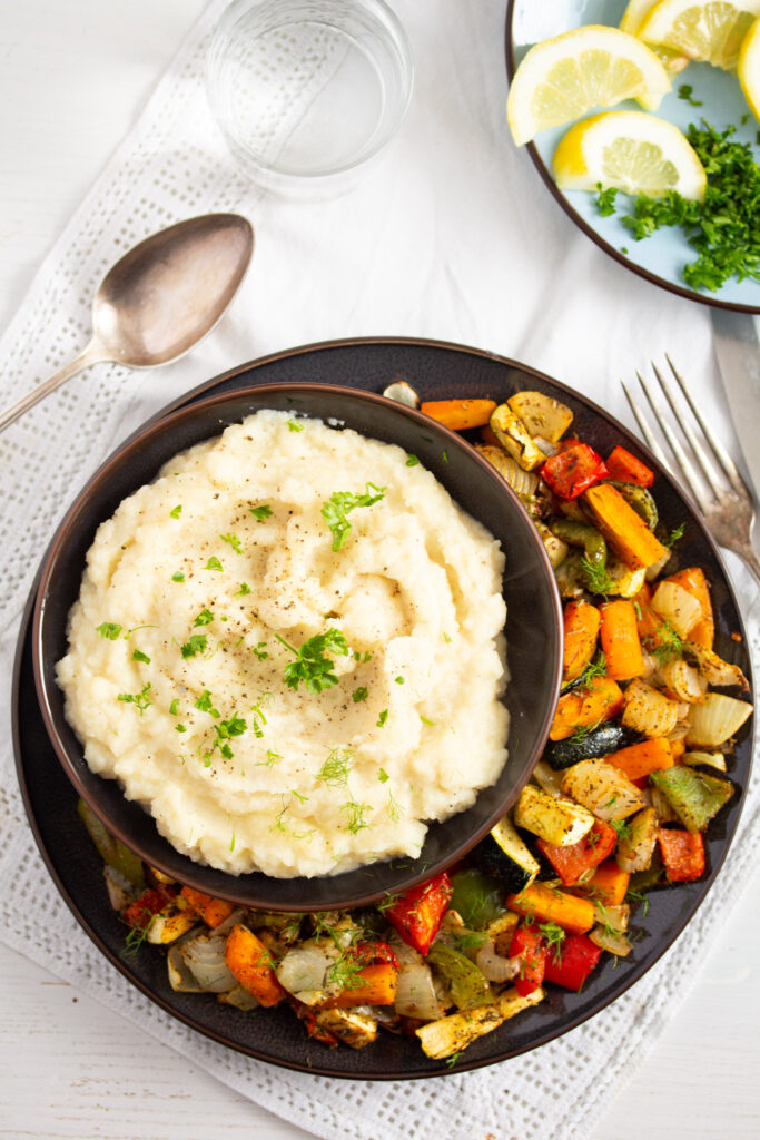overhead image of a plate of roasted vegetables served with creamy mash.