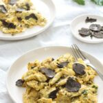 scrambled eggs on white plates with truffles.