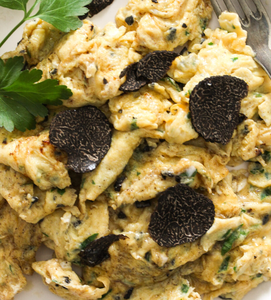 close up of plate with scrambled eggs.