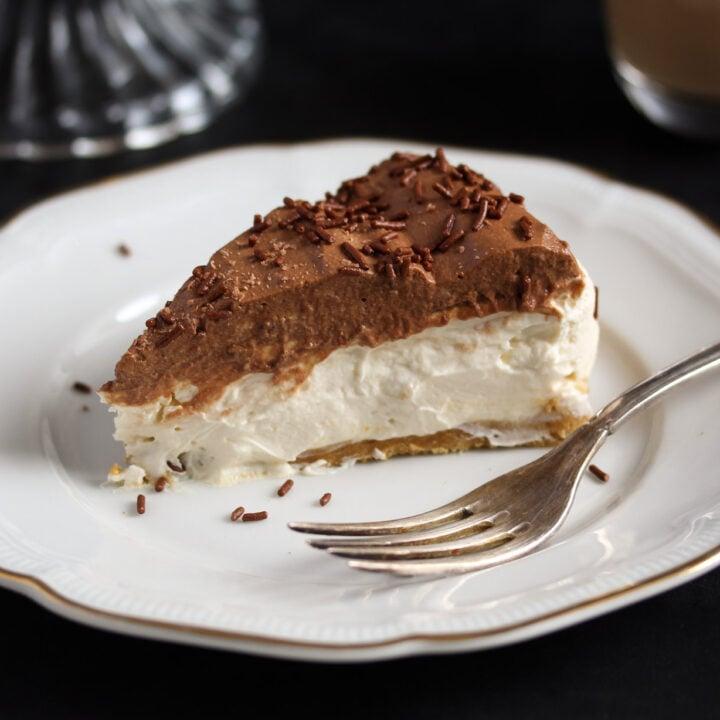 creamy slice of irish cream cheesecake on a vintage plate.