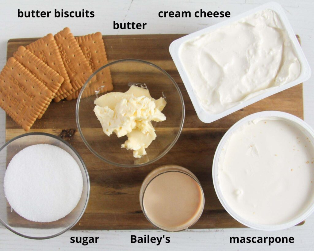 biscuits, cream cheese, mascarpone, sugar, butter, baileys on a wooden board.