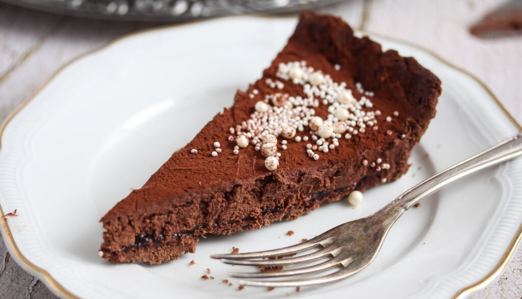 sliced creamy pieces of tart on a plate with a fork.