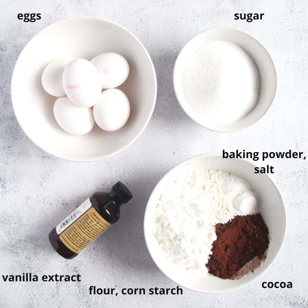 eggs, flour, vanilla, sugar in bowls on the table.