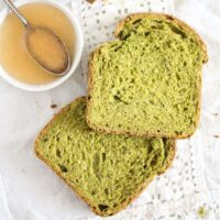 green spinach bread slices and a small bowl of jam.