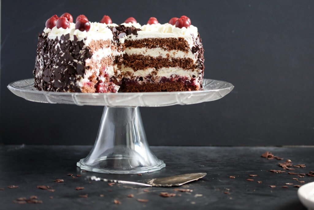 inside layers of a black forest gateau filled with whipped cream.