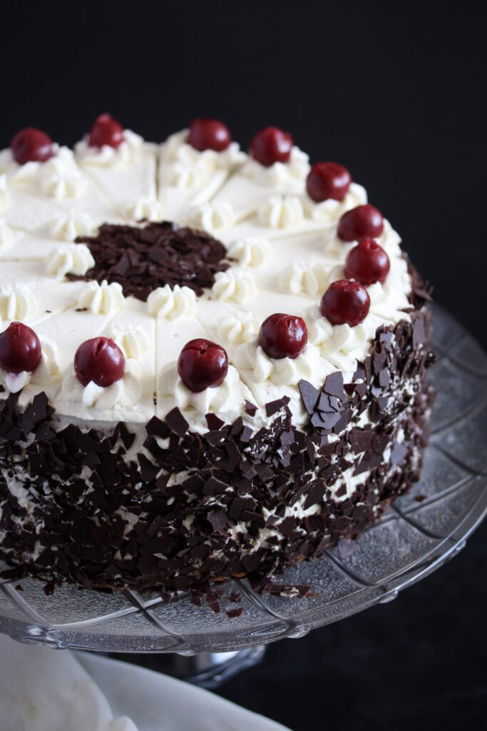 black forest gateau on a tall platter.