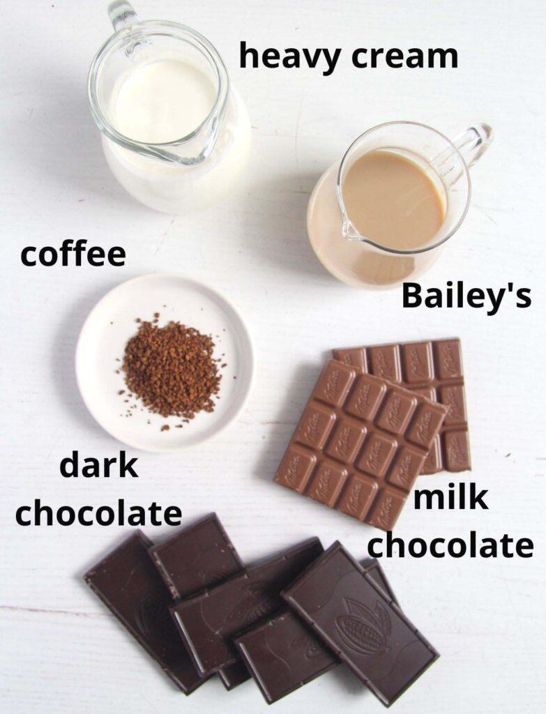 cream, bailey's, coffee, chocolate on a white table.