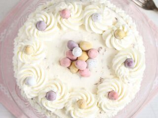 mini egg cheesecake on a pink cloth seen from above.