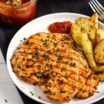 grilled chicken breast with potatoes and peri peri sauce.