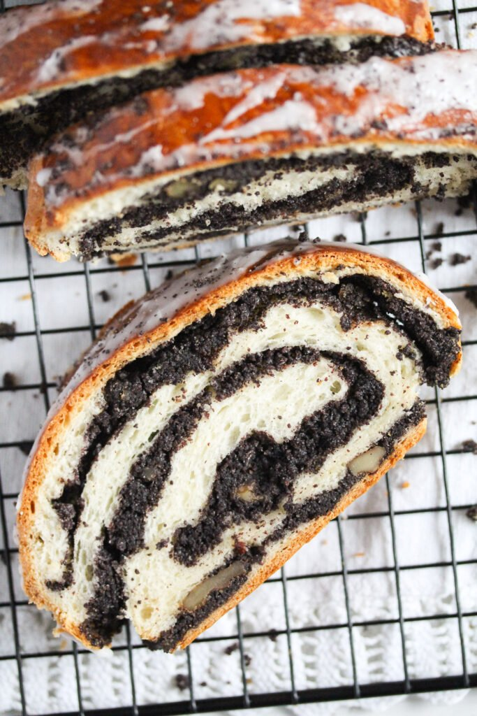 close up of a slice of poppy seed roll.