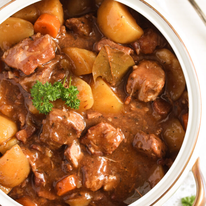slow cooked lamb casserole with potatoes close up.