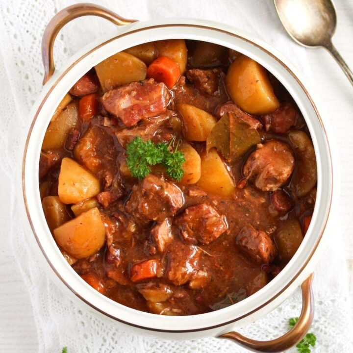 lamb casserole in slow cooker in a vintage pot.