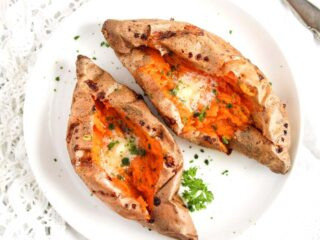 air fryer baked sweet potatoes with butter and herbs.