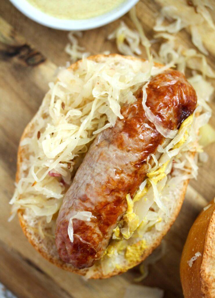 air fried bratwurst served in a bun with sauerkraut.