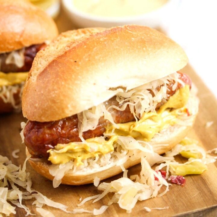 bun stuffed with brat, sauerkraut and mustard.