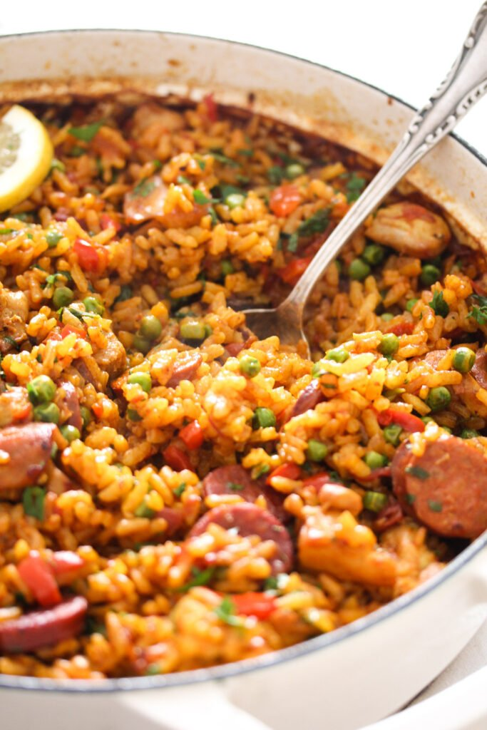 sausage and rice dish with vegetables in a large pot.