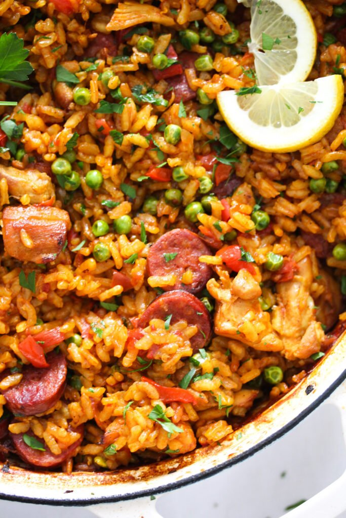 close up paella with sausage and chicken.