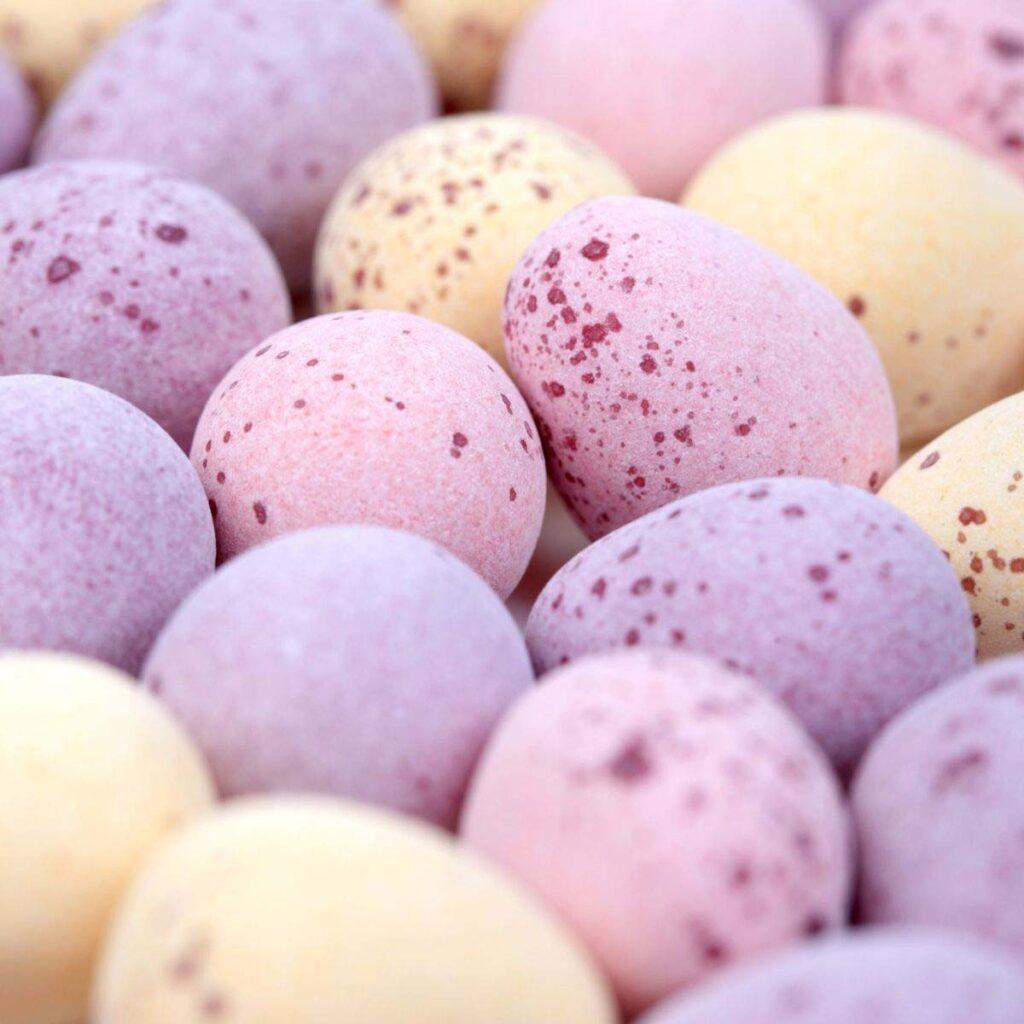 pastel colored cadbury mini eggs close up.