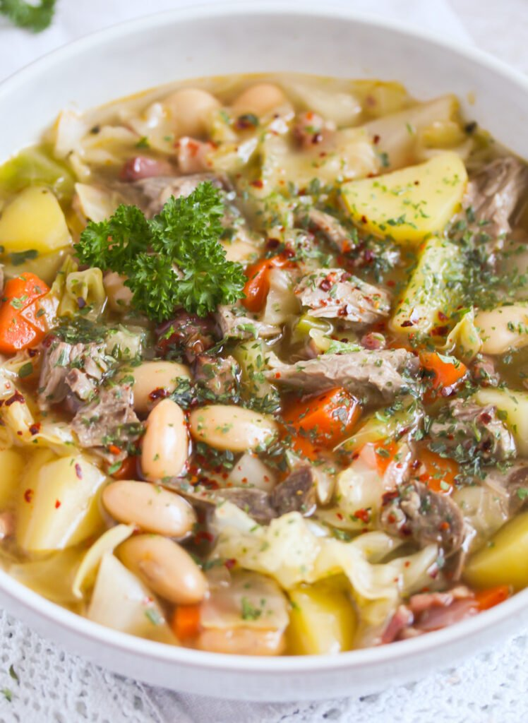 close up thick soup with meat and vegetables.