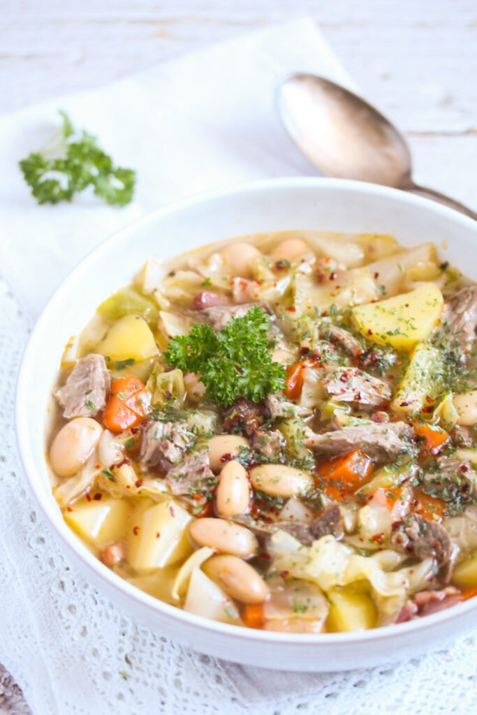 soup made from lamb bones with beans and potatoes in a bowl.