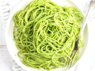 wild garlic pasta on a white plate overhead view.