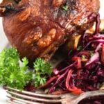 large pork knuckle on a plate.