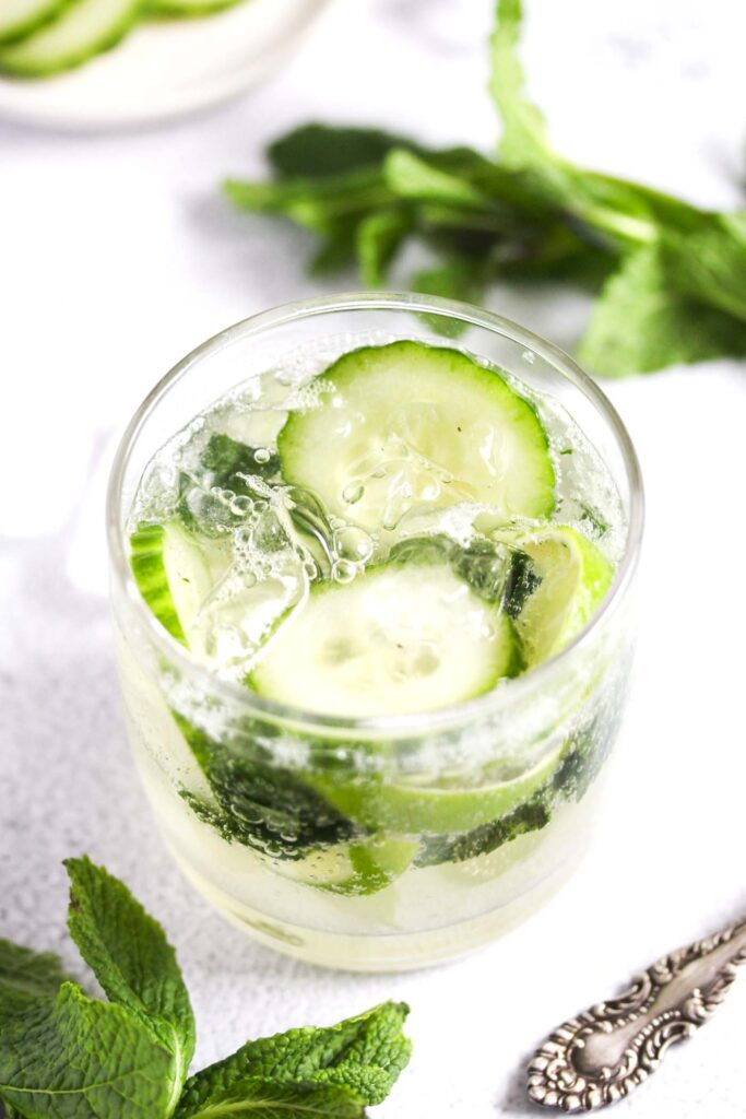 mint and cucumber mojito with gin in a glass.
