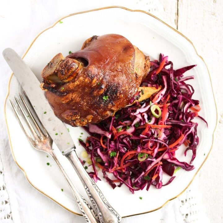 crispy pork hock served with red cabbage slaw.